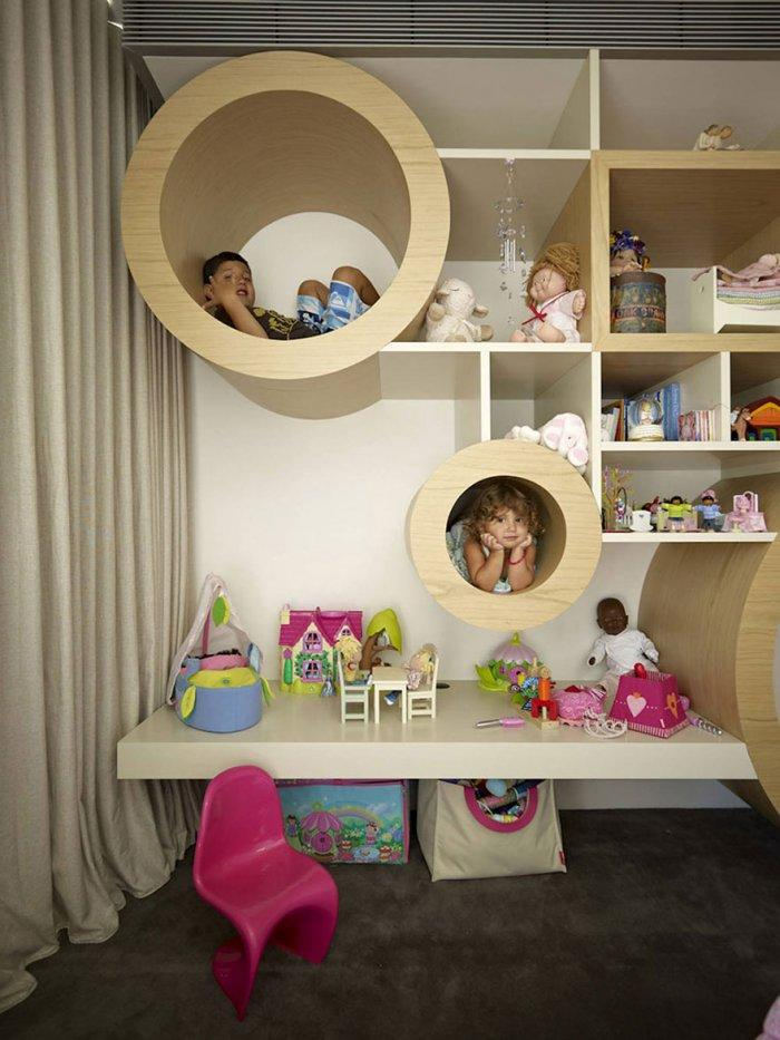 Kids' playroom with tubes for hiding