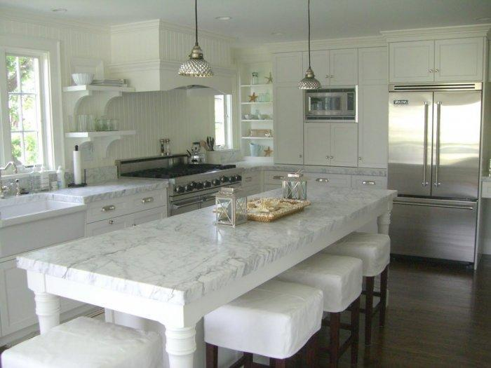 Kitchen design in white with stylish island in the middle