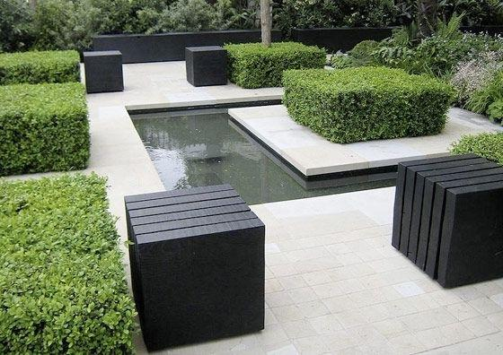 Lounge minimalist garden with tables and water pond