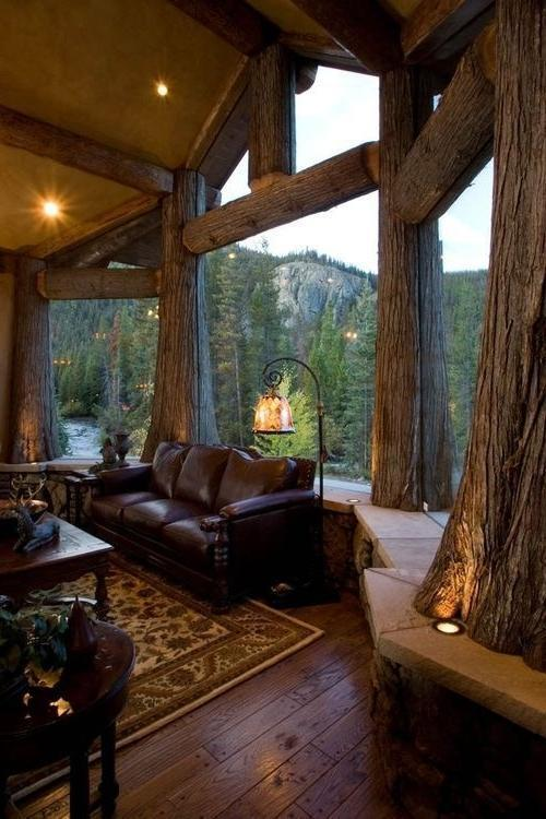 Luxurious rustic cabin room with giant glass window facade