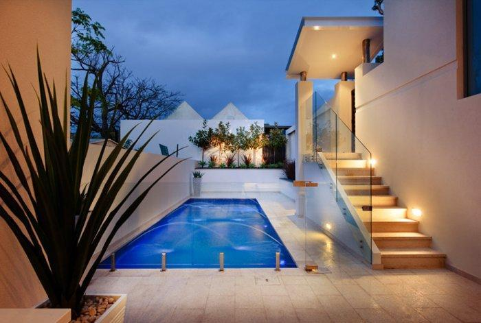 Luxury pool with view towards the ocean nearby