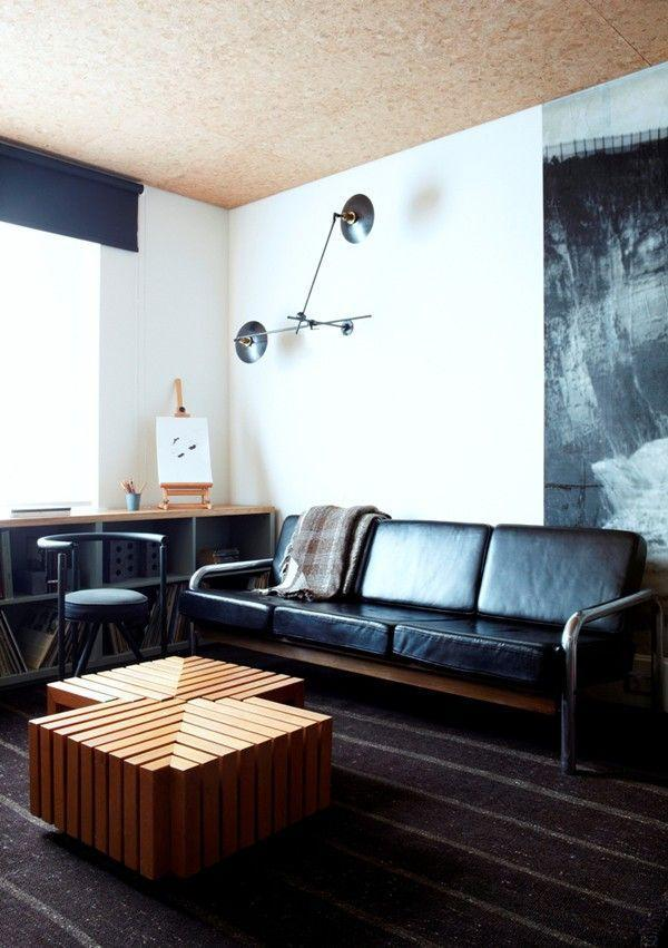 Mid Century Modern Black Leather Sofa In A Contemporary Home With  Interesting Accents