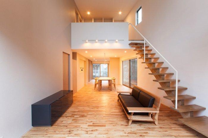 Minimalist Japanese living room located on the first floor