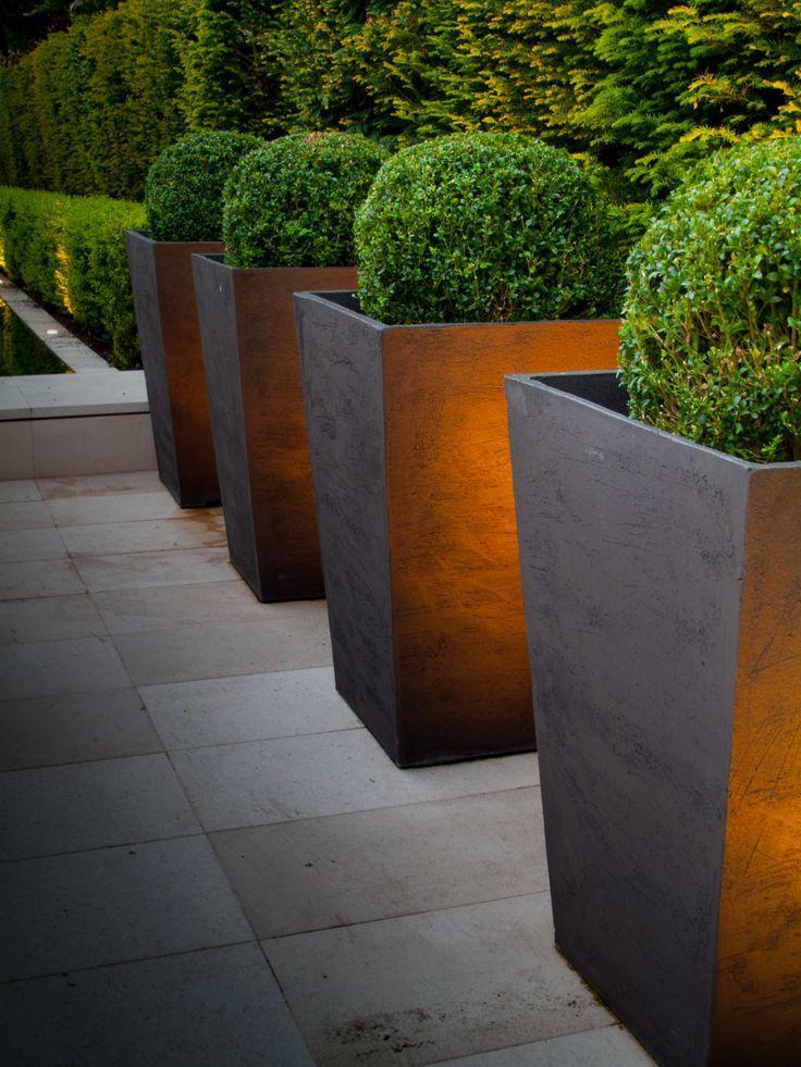 Minimalist flower pots in a modern garden
