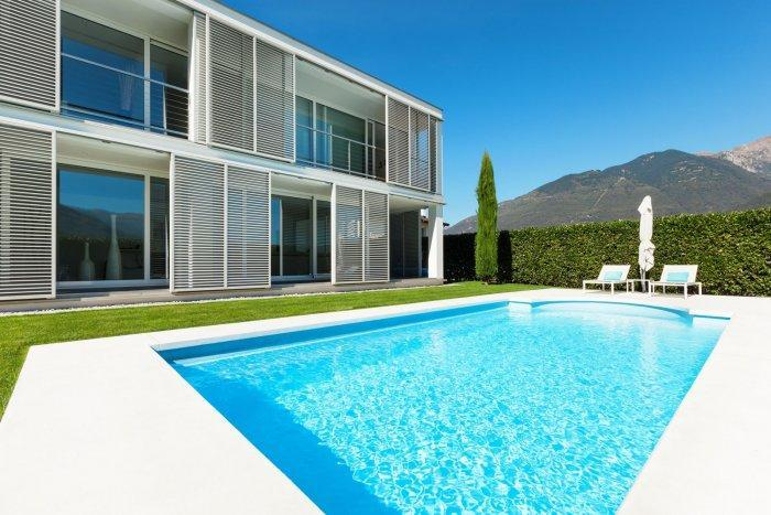 Minimalist swimming pool in front of a contemporary house
