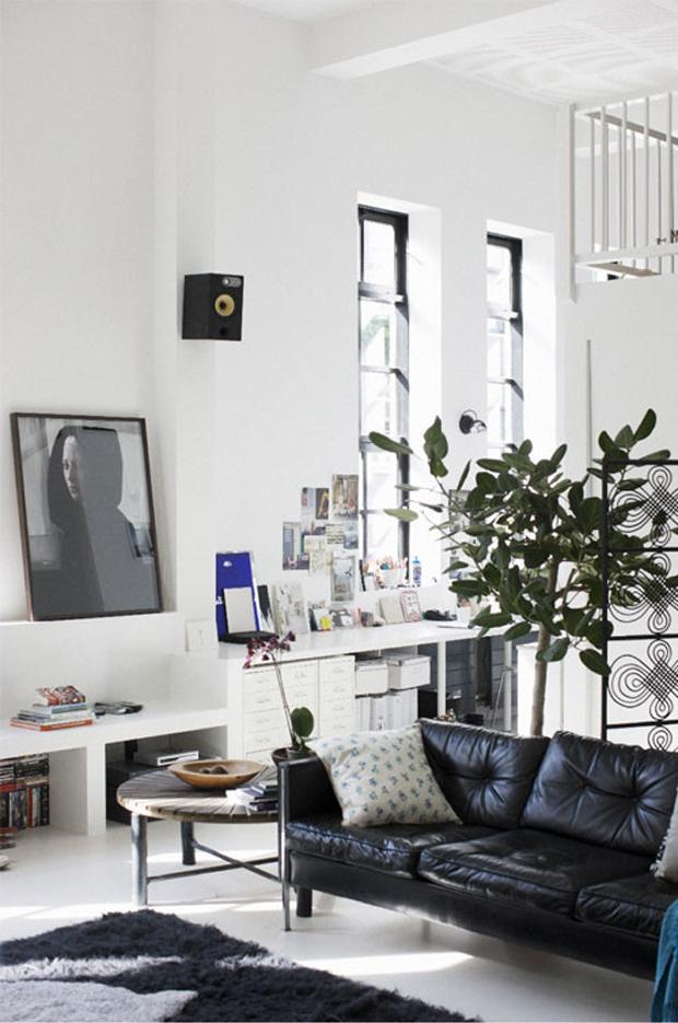 Modern black leather sofa in a stylish Scandinavian home