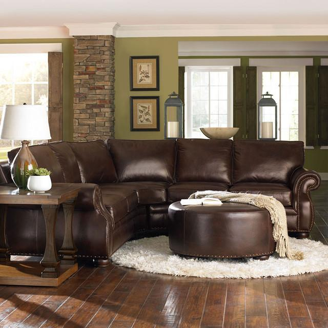 Modern brown leather sofa inside a living room