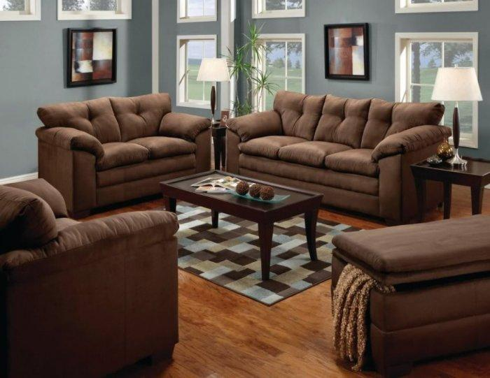 Modern brown living room with dark sofas