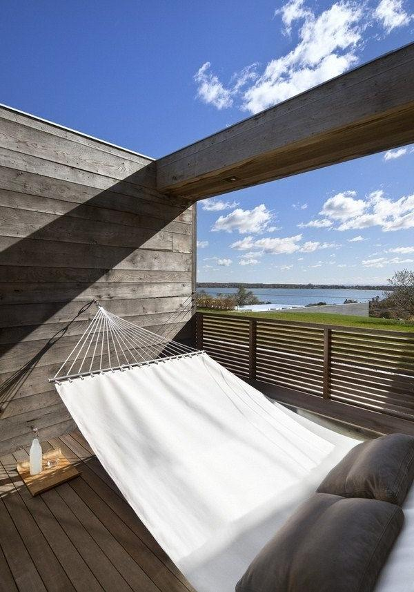 Modern hammock placed at the wooden deck