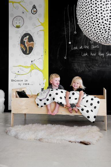 Modern kids' room with wall painted with black chalkboard paint