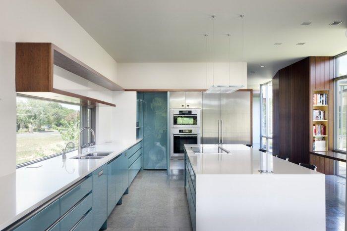 Modern kitchen island in glossy white