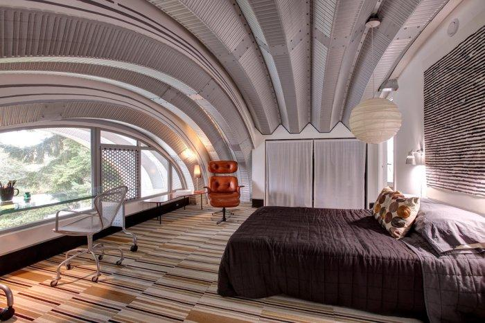 Modern Master Bedroom With Arched Celing And Window