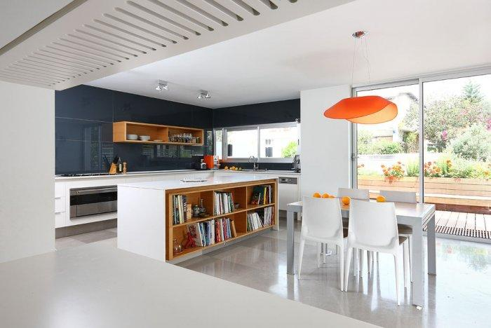 Modern pendants and furniture in a contemporary kitchen