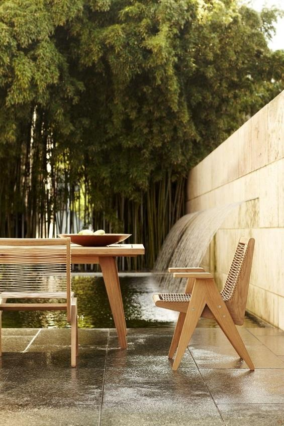 Modern wood chair next to a outdoor dining table