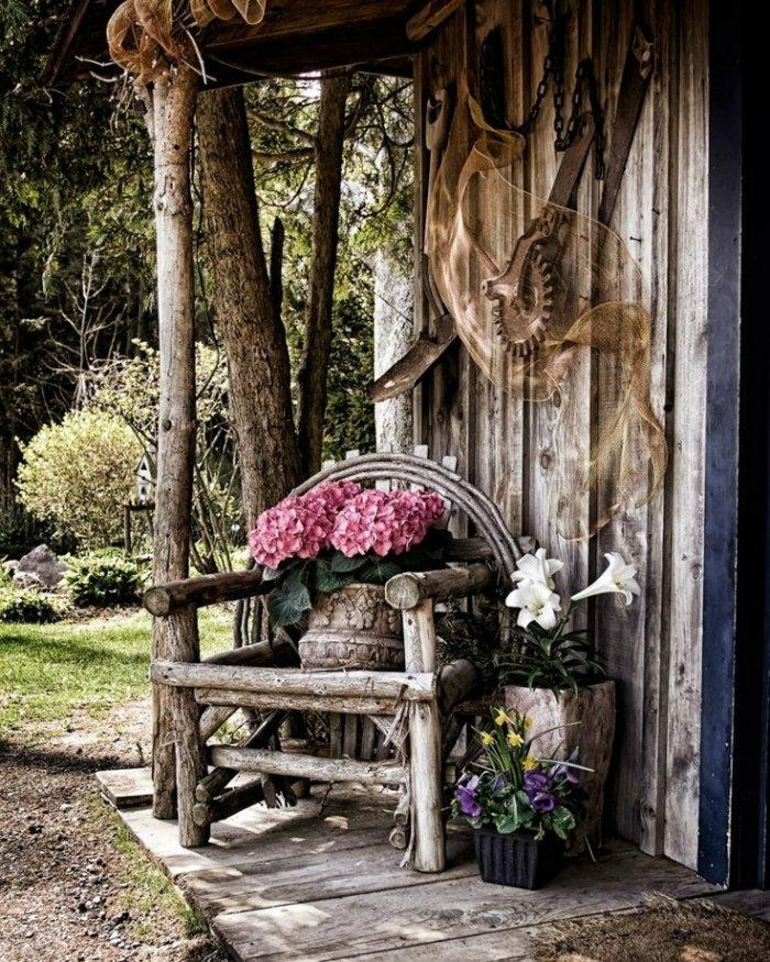 Rustic vintage chair in the front porch of a mountain getaway