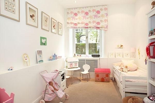 Scandinavian baby room design in white