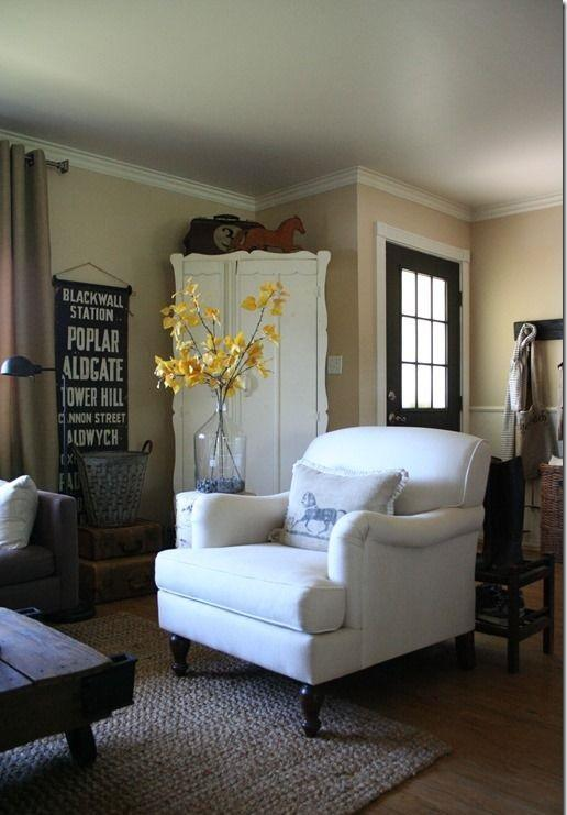 Shabby chic armchair in white color with yellow flowers beside