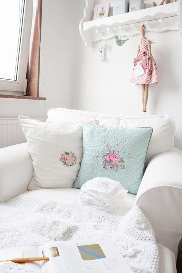 Shabby chic armchair with white and pale blue pillows