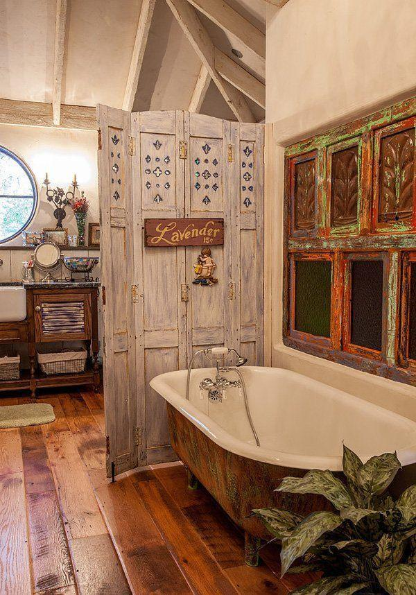 Shabby chic bathroom with vintage bathtub