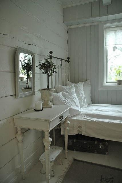 Shabby chic bedroom with simple bedside table