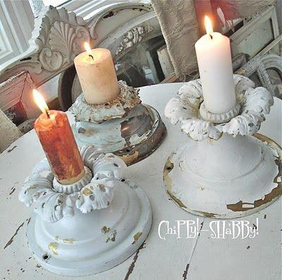 Shabby chic candles placed in vintage candleholders