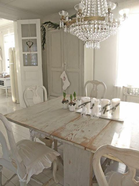 Shabby Chic Dining Room With Massive Table And Classic Chandelier