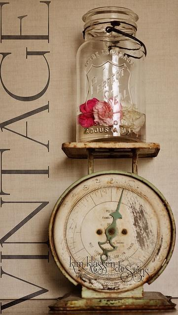 Shabby chic jar palced on scales