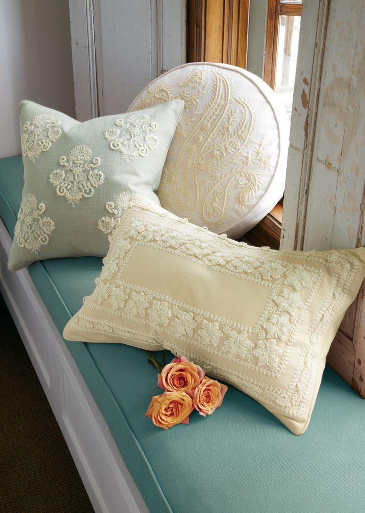 Shabby chic pillows with decorative ornamentation