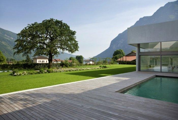 Simple and stylish wooden deck with small pool in the middle
