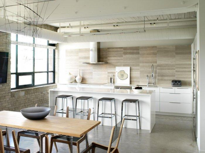 Simple kitchen with white cabinets and wood accents