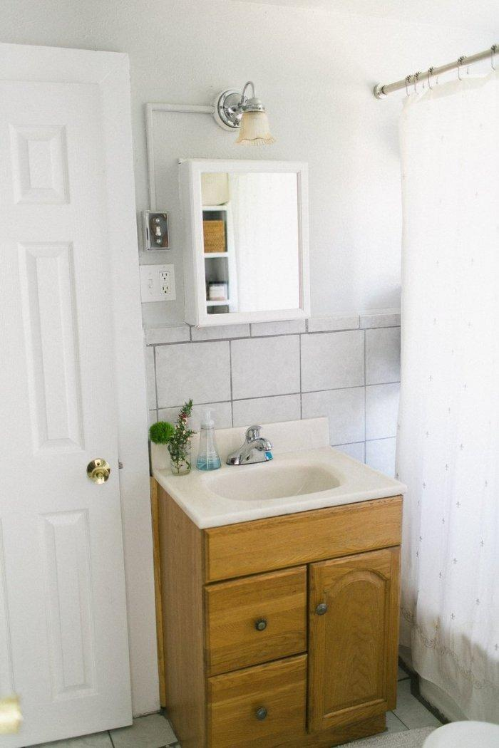 Small bathroom with tiny cabinet and sink