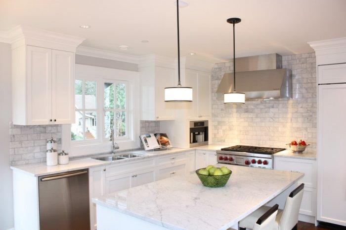 Small kitchen interior with huge island with marble top