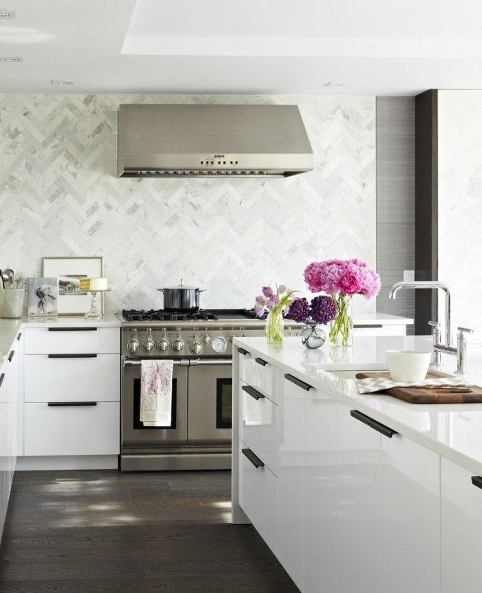 Small white kitchen with glossy modern cabinetry