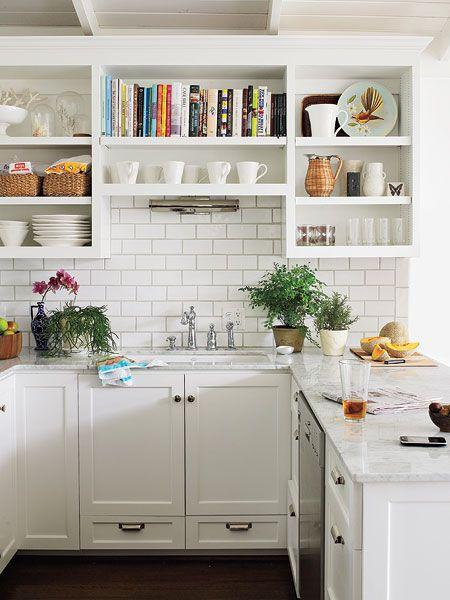 Small white kitchen with interesting shelves