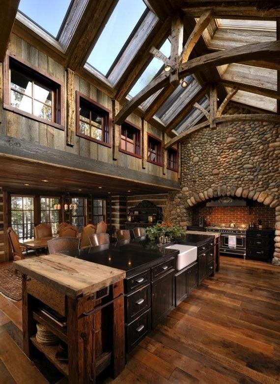 Spacious log cabin kitchen with long island in the middle ...