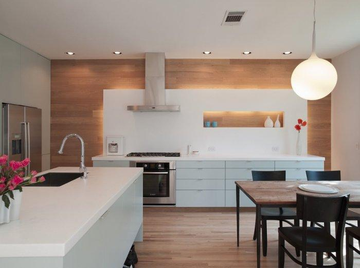 Stylish kitchen design with wood wall accents