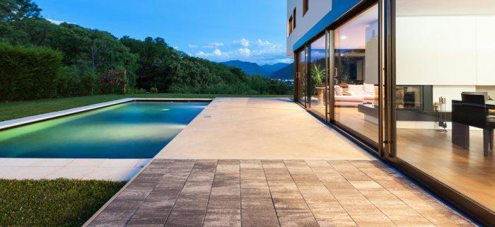 Stylish minimalist front garden with impressive pool and concrete floor
