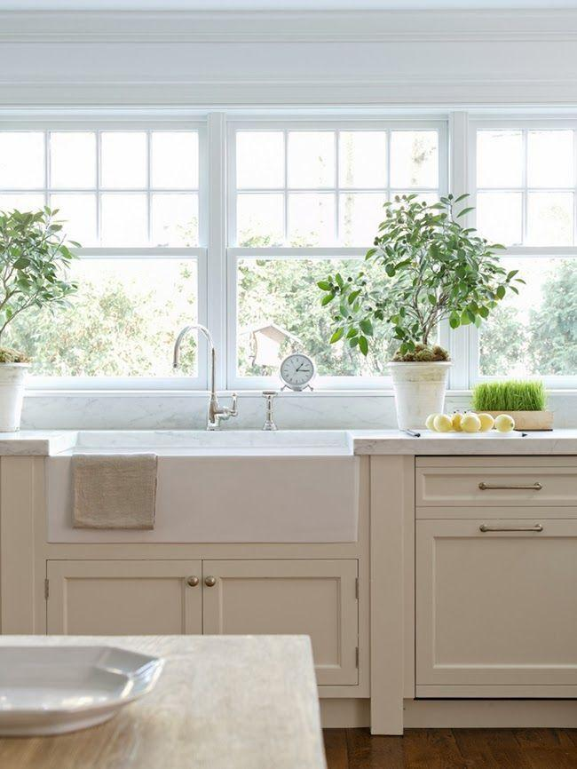 Sunny kitchen design with white cabinets