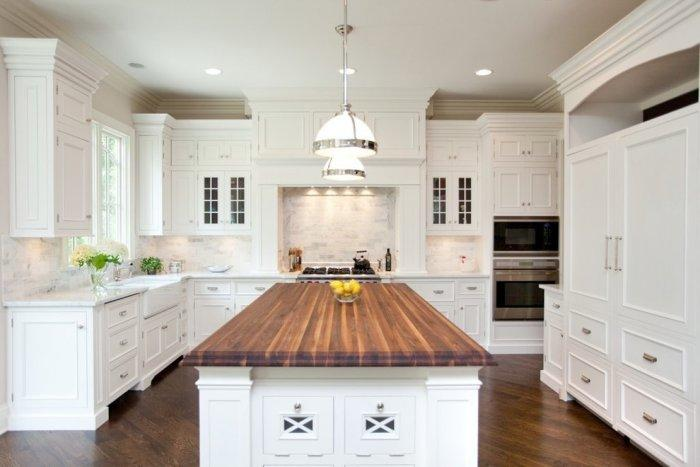 Traditional kitchen with toe kick furniture and island pilasters