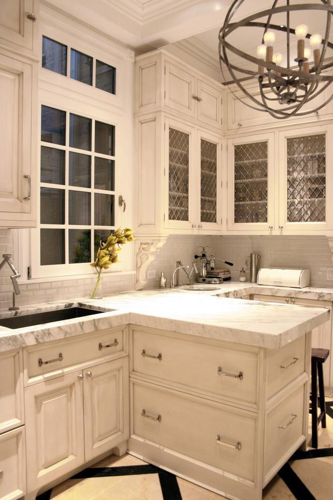 Traditional kitchen with white marble countertops