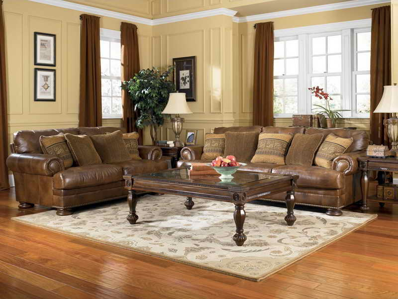 Traditional living room interior with dark brown leather sofas