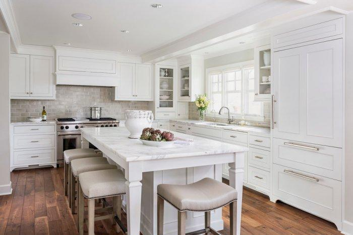 Traditional white kitchen with oak floor panels