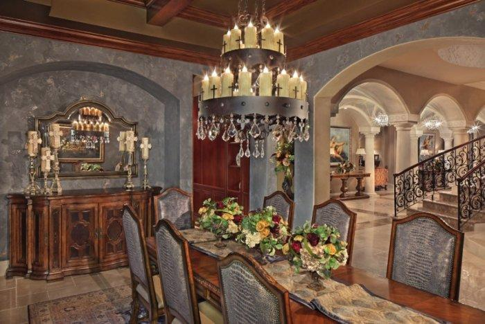 Victorian mansion dining room with candle chandelier