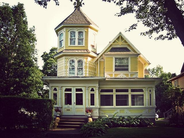 Vintage Victorian house with yellow facade
