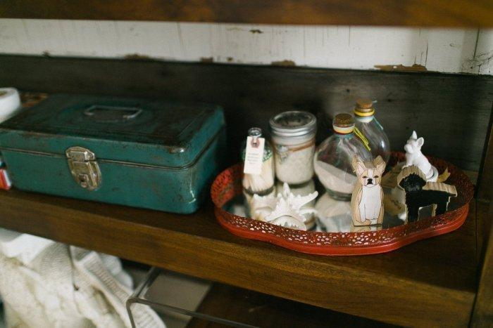 Vintage box decorates the reclaimed wood shelves