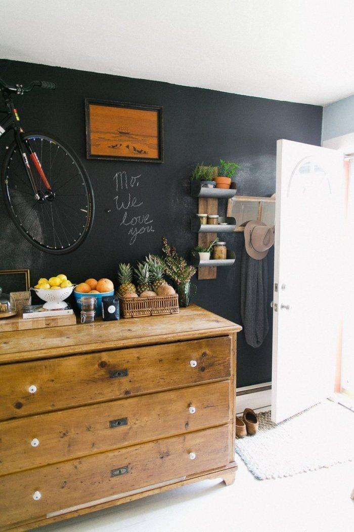 Vintage chest of drawers and black wall