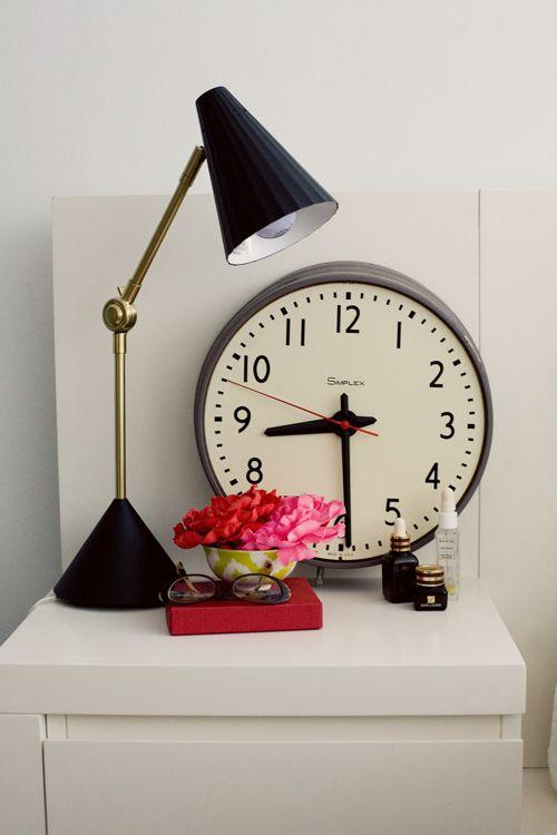 Vintage clock decorating a modern bedside table