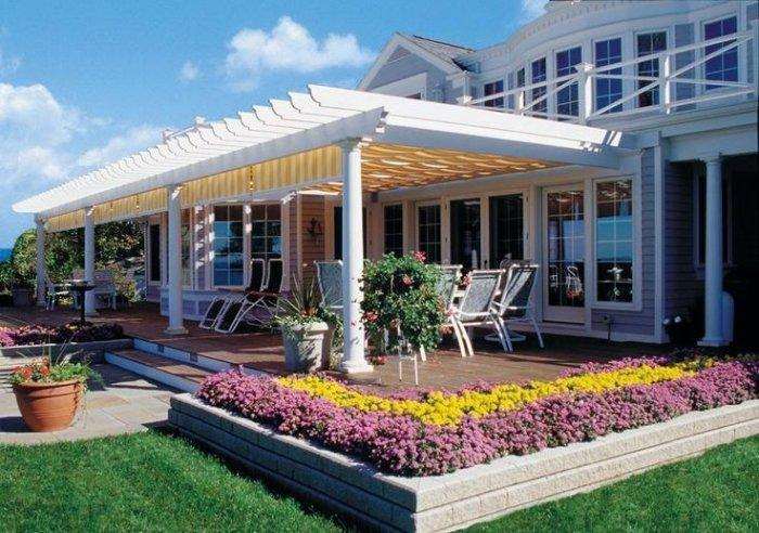 Vinyl Pergola Shelter In Front Of A Luxurious House