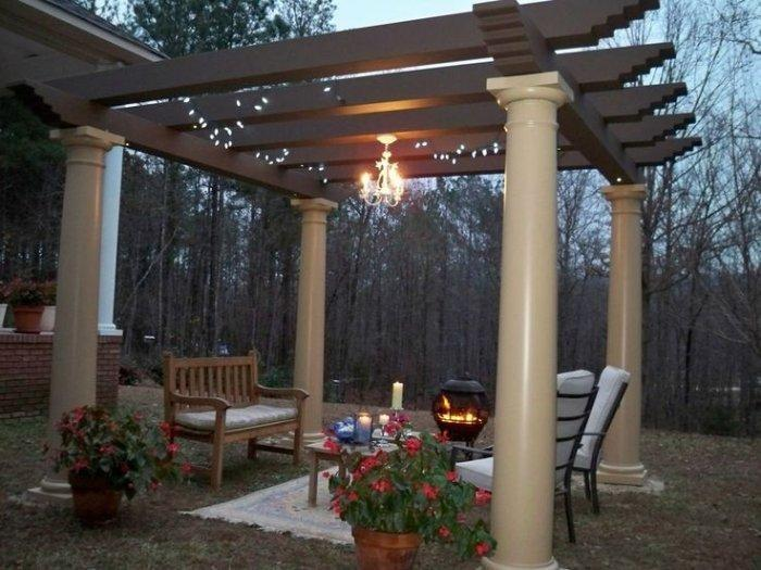 Vinyl Pergola With Glossy Columns In The Garden Of A House