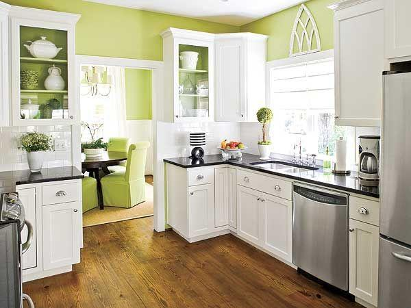 White and green kitchen with open plan interior